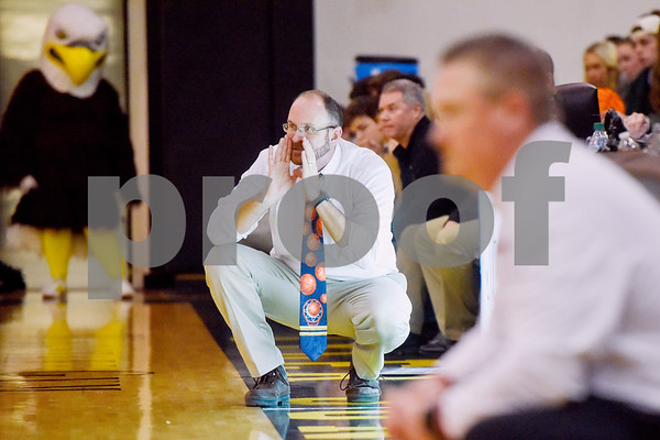 Canton head coach Matt Kirschner squats and yells as he watches the game during a high school basketball regional quarterfinal playoff game at Tyler Junior College in Tyler, Texas, on Tuesday, Feb. 27, 2018. The Carthage Bulldogs beat the Canton Eagles 57-42. (Chelsea Purgahn/Tyler Morning Telegraph)