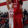 Colin Myers of Firelands shoots over Grant Howes of Fairview from the baseline during the first quarter. Randy Meyers -- The Morning Journal