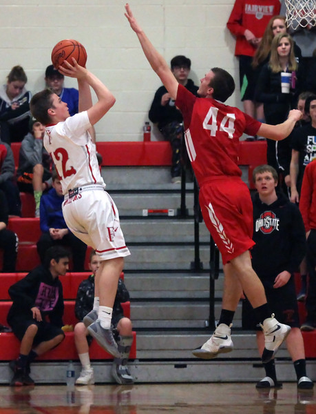 Luke Howes of Fairview shoots over Colin Myers of Firelands during the third quarter. Randy Meyers -- The Morning Journal