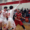 Fireland's Dominic Januzzi drives around the double team by  Noah Mesaros, left, and Owen Morrison of Fairview during the first quarter. Randy Meyers -- The Morning Journal
