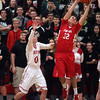 Bradley Soltis of Firelands reaches for a rebound over Owen Morrison of Fairview during the third quarter. Randy Meyers -- The Morning Journal