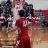 Noah Mesaros of Fairview shoots a long jumper over Colin Myers of Firelands during the second quarter. Randy Meyers -- The Morning Journal