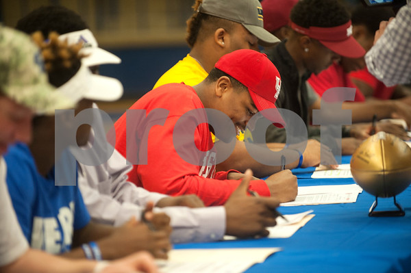 Braylon Jones signs his letter of intent for the University of Houston. Thirteen John Tyler High School seniors signed letters of intent to play collegiate football Wednesday Feb. 3, 2016.  (Sarah A. Miller/Tyler Morning Telegraph)