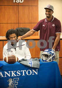 Frankston High School senior Kendrick Rodgers is congratulated by his uncle Quentily Harmon Jr. after announcing his intent to play football at Texas A&M University Wendesday.  (Sarah A. Miller/Tyler Morning Telegraph)