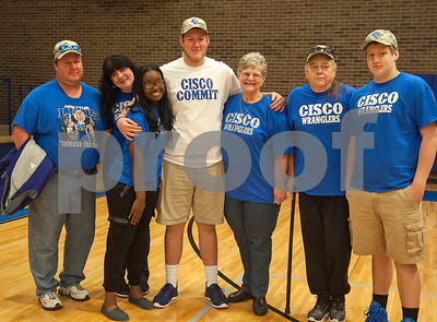 John Tyler football player Alex Bridges is pictured with his family after committing to Cisco College Wednesday. Pictured from left: father Brian Bridges, mother Michelle Bridges, girlfriend Kinsley Meadowbrook, Alex Bridges, grandmother Dixie Fortune, grandfather Jim Fortune and brother Jackson Bridges. Thirteen John Tyler High School seniors signed letters of intent to play collegiate football Wednesday Feb. 3, 2016.  (Sarah A. Miller/Tyler Morning Telegraph)