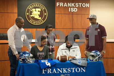 Frankston High School senior Kendrick Rodgers signs his letter of intent to play football at Texas A&M University Wendesday. Pictured from left: grandfather Quentily Harmon, mother Tiffany Harmon, sister Tia Billingsly, 11, and uncle Quentily Harmon Jr.  (Sarah A. Miller/Tyler Morning Telegraph)