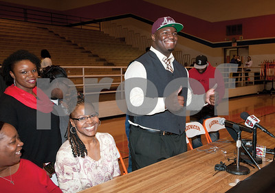 photo by Sarah A. Miller/Tyler Morning Telegraph  Gladewater High School's defensive lineman Daylon Mack  gives two thumbs up after his National Signing Day announcement committing to Texas A&M Wednesday in Gladewater, Texas. ESPN ranks Mack as the No. 6 overall recruit in the nation.