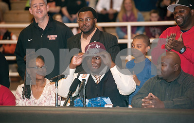 photo by Sarah A. Miller/Tyler Morning Telegraph  Gladewater High School's defensive lineman Daylon Mack  puts on a Texas A&M hat during his National Signing Day announcement committing to Texas A&M live on ESPNU Wednesday in Gladewater, Texas. ESPN ranks Mack as the No. 6 overall recruit in the nation. Pictured at left is his mother Geraci Mack and at right his father Coris Mack.
