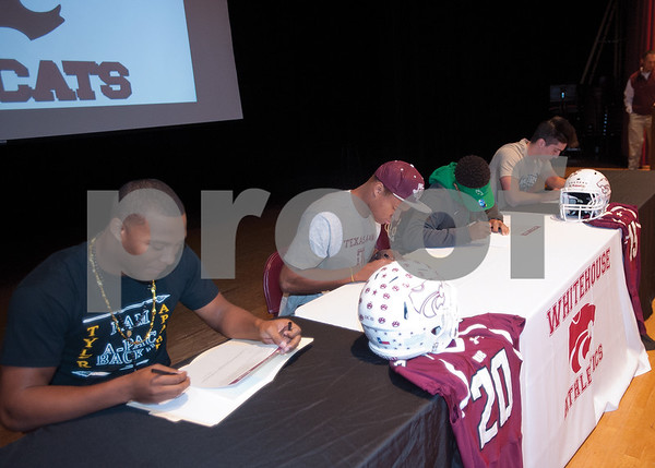 The athletes sign on the dotted line for their respective colleges. (Victor Texcucano/Staff)