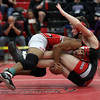Brookside's David Ocasio takes down Connor Eckman of Firelands during the 113-pound championship. Randy Meyers -- The Morning Journal