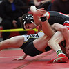 Firelands Payton Burgdorf takes ZachLahood of Black River to the mat on his way to the 106-pound  championship title at the PAC Tournament. Randy Meyers -- The Morning Journal