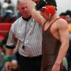Buckeye's Eric Bartos is signaled as the winner and champion of the 120-pound class. Randy Meyers __ The Morning Journal
