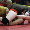 Mike Clark of Buckeye forces Seth Majewski to the mat for a pin during the 126-pound match at the PAC Tournament. Randy Meyers -- The Morning Journal