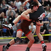 Eric Bartos of Buckeye takes down Brad Huhn of Brookside during the120-pound championship match. Bartos won the title. Randy Meyers -- The Morning Journal