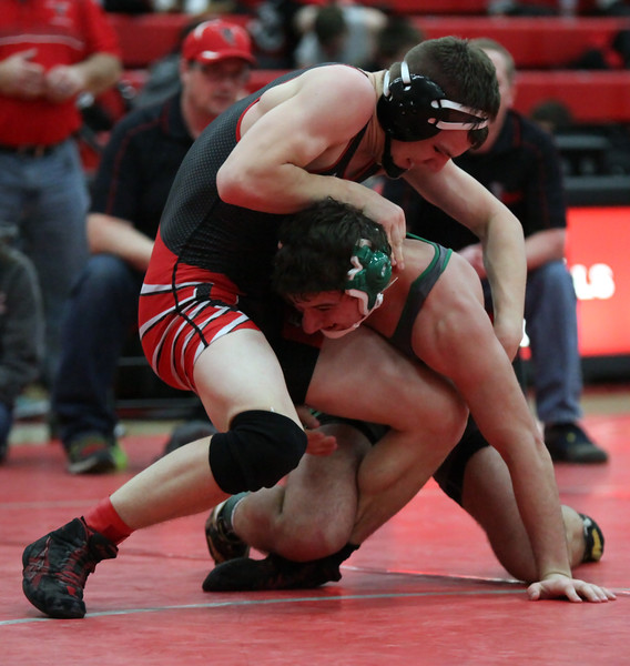 Columbia's Mike Jacobucci has a hold advantage over Kyle Hieb of Firelands during the sem final match of the 170-pound class during the PAC Tournament. Randy Meyers -- The Morning Journal