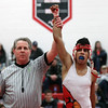 Brookside's David Ocasio is signaled as the champion of the 113-pound class. Randy Meyers -- the Morning Journal