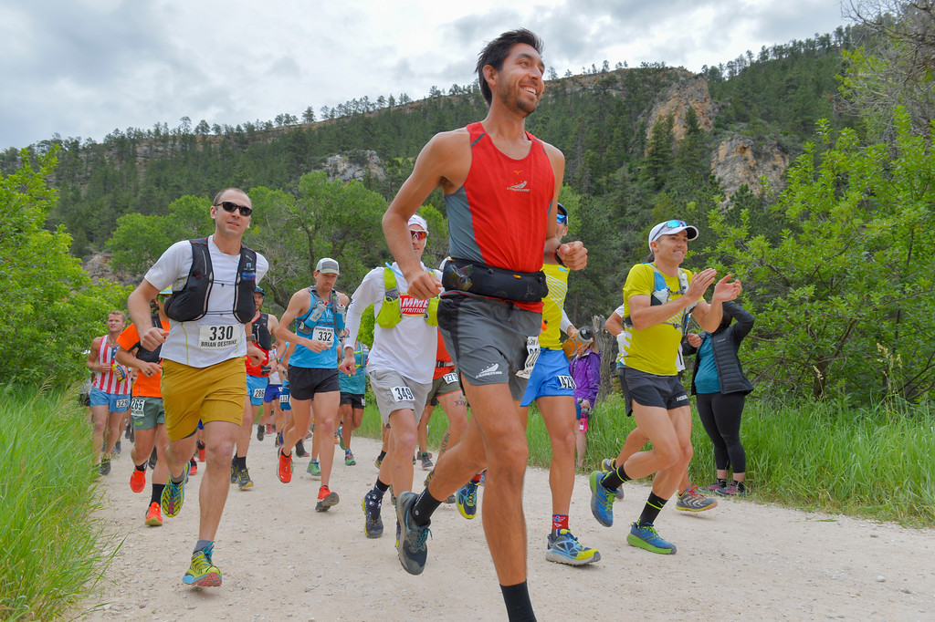 Justin Sheely | The Sheridan Press<br /> Alex Ho of San Francisco, California, front, heads the start of the 100-mile run during the 25th Bighorn Mountain Wild and Scenic Trail Run Friday morning in the Tongue River Canyon near Dayton. Hundreds of runners from across the globe visit Sheridan and Dayton, Wyoming, to compete in the ultra marathons.