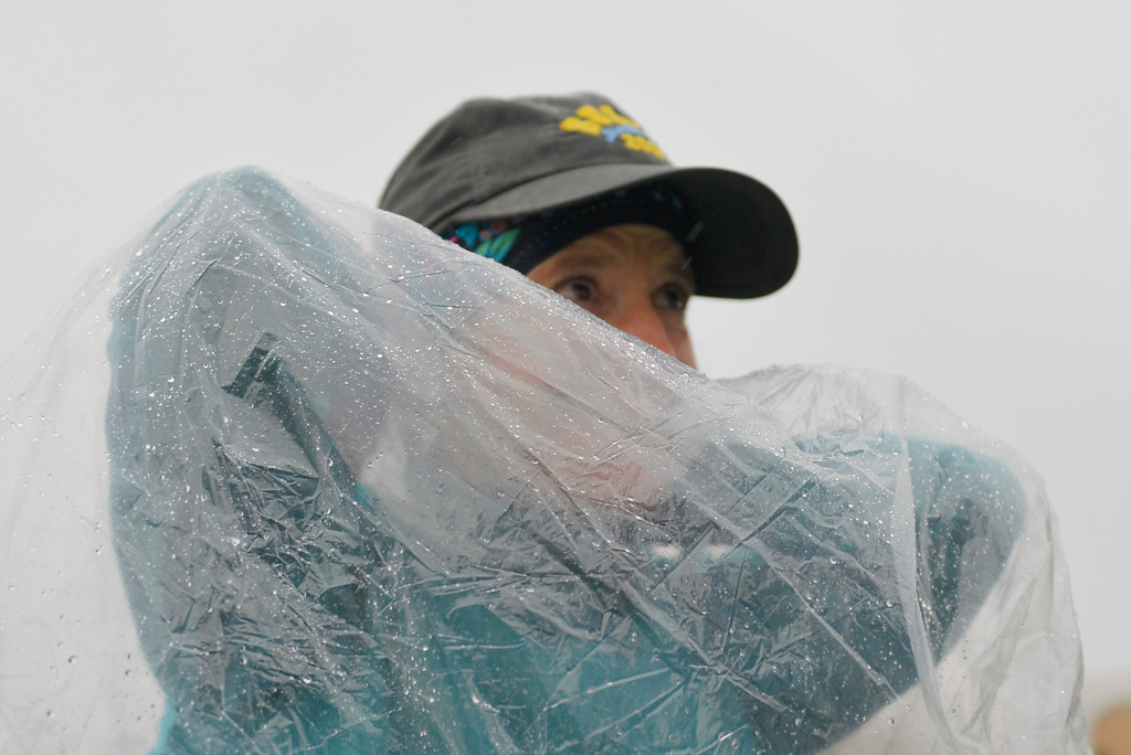 Justin Sheely | The Sheridan Press<br /> Diane Roman of Story, Wyoming, waits under a rain poncho prior to the start of the 32-mile race during the 25th annual Bighorn Mountain Wild and Scenic Trail Run Saturday at the Dry Fork aid station. Cold rain and wind brought a soggy start to Saturday's events. Roman, who has competed in the event for 23 years, said that she hasn't seen this kind of weather during the annual trail run.