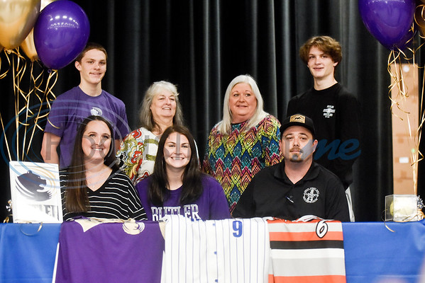 Hannah Knox, bottom center, smiles with family during a National Signing Day event at Lindale High School in Lindale, Texas, on Wednesday, Feb. 6, 2019. (Chelsea Purgahn/Tyler Morning Telegraph)