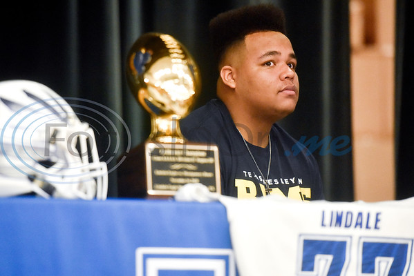 Casen Chaney sits on stage during a National Signing Day event at Lindale High School in Lindale, Texas, on Wednesday, Feb. 6, 2019. (Chelsea Purgahn/Tyler Morning Telegraph)
