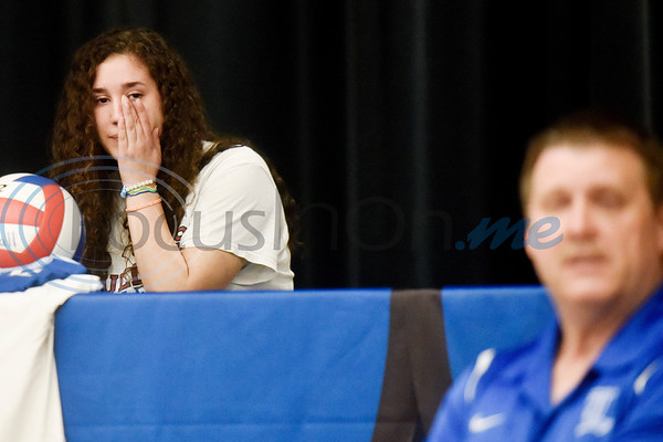Jennifer Moyer wipes a tear away as her father Ron talks about how Jennifer's mother, who passed away from liver cancer two years ago, would be so proud of her if she were there today during a National Signing Day event at Lindale High School in Lindale, Texas, on Wednesday, Feb. 6, 2019. (Chelsea Purgahn/Tyler Morning Telegraph)