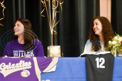 Hannah Knox and Jennifer Moyer sit on stage and smile during a National Signing Day event at Lindale High School in Lindale, Texas, on Wednesday, Feb. 6, 2019. (Chelsea Purgahn/Tyler Morning Telegraph)