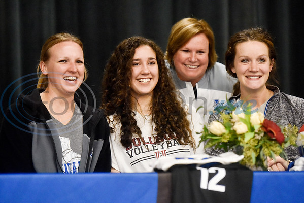 Jennifer Moyer, second from left, smiles with coaches during a National Signing Day event at Lindale High School in Lindale, Texas, on Wednesday, Feb. 6, 2019. (Chelsea Purgahn/Tyler Morning Telegraph)