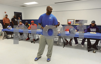 photo by Sarah A. Miller/Tyler Morning Telegraph  John Tyler High School football coach Ricklan Holmes talks about his players who are committing to play football at the collegiate level Wednesday during a signing ceremony.