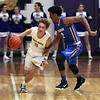 Vermilion guard Drew Dawson brings the ball upcourt against the pressure applied by Deuce Martin of Clearview during the first quarter. Randy Meyers -- The Morning Journal