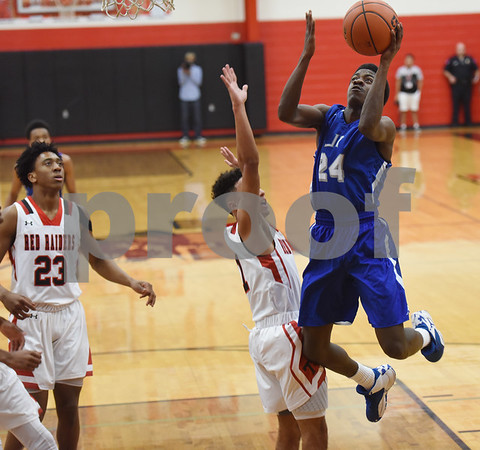 John Tyler's (24) Mashaud Moore scores a basket as they play Robert E. Lee Tuesday Feb. 7, 2017 at Robert E. Lee.  (Sarah A. Miller/Tyler Morning Telegraph)