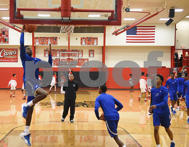 John Tyler High School head boys basketball coach Cedeno Clark watches his team warm up Tuesday Feb. 7, 2017 at Robert E. Lee.  (Sarah A. Miller/Tyler Morning Telegraph)
