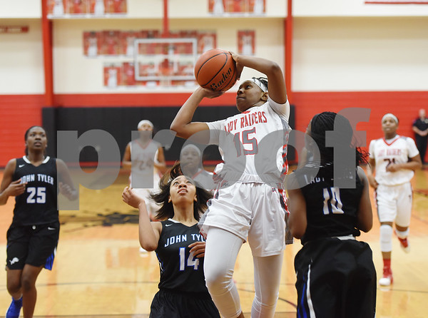 Robert E. Lee High School's Ja'Kayla Bowie goes for a basket in their game against rival John Tyler Tuesday Feb. 7, 2017 at Robert E. Lee.  (Sarah A. Miller/Tyler Morning Telegraph)