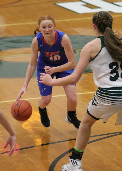 Bay's Maddie Holmes keeps her eye on the defense as she comes in to make the pass. Amanda K. Rundle -- The Morning Journal