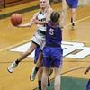 Elyria Catholic's Sam Filliaggi takes a shot over a Bay defender. Amanda K. Rundle -- The Morning Journal