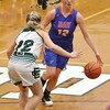 Bay's Maddie Edgerly  drives toward the hoop past an Elyria Catholic defender. Amanda K. Rundle -- The Morning Journal