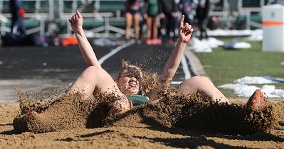 Medina senior Riley Braun lands in the sand pit during the long jump competition at the Medina Relays Saturday morning. Aaron Josefczyk/Gazette photo