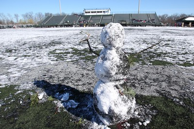 A snowman watches the Medina Relays Saturday morning. Aaron Josefczyk/Gazette photo