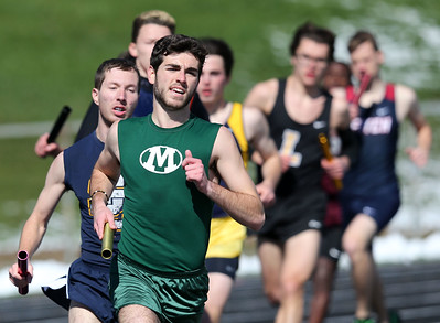 Medina's Matt Stump runs the lead off lleg of the 4x1600 race at the Medina Relays Saturday morning. Aaron Josefczyk/Gazette photo
