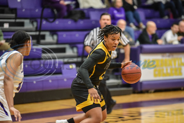 Sophomore Kierra Brimzy (25) dribbles across the court on Saturday, February 9 during a game hosted by Jacksonville College. The Lady Apaches went on to win the game 75-50. (Jessica T. Payne/Tyler Morning Telegraph)