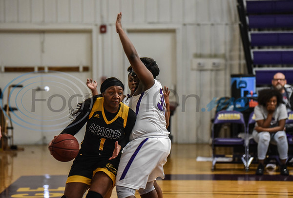 Te'Aire Hambrick (1) of TJC attempts to pass KymMya Thomas (30) of Jacksonville College during their game hosted by Jacksonville College on Saturday, February 9. TJC went on to win 75-50. (Jessica T. Payne/Tyler Morning Telegraph)