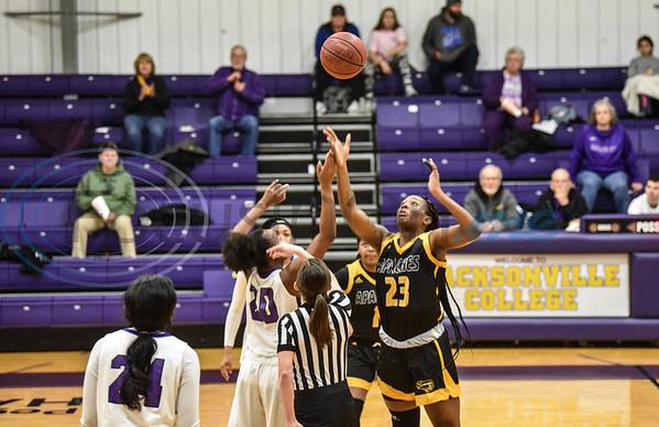 Freshman Alexis Wheeler (20) of Jacksonville College and Freshman Frankazia Boyd (23) of Tyler Junior College jump for the ball during tip off on Saturday, February 9. (Jessica T. Payne/Tyler Morning Telegraph)