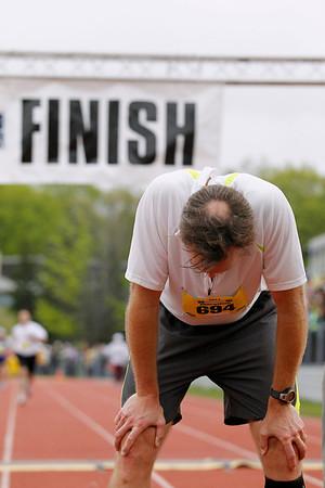 Record-Eagle/Jan-Michael Stump<br /> Runners finish the half-marathon in Saturday's 29th annual Bayshore Marathon.#694
