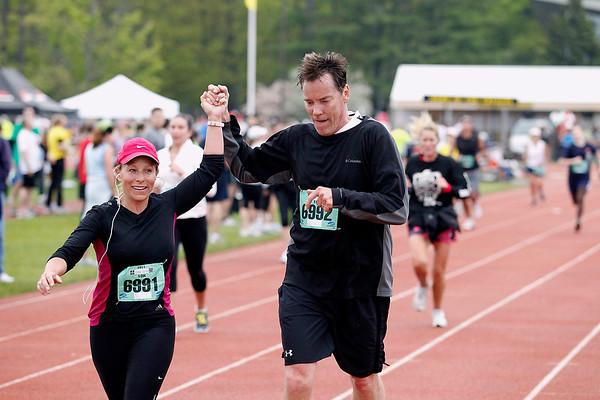 Record-Eagle/Jan-Michael Stump<br /> Runners finish the 10k race in Saturday's 29th annual Bayshore Marathon. #6991, 6992