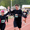 Record-Eagle/Jan-Michael Stump<br /> Runners finish the 10k race in Saturday's 29th annual Bayshore Marathon. #6991, 6992