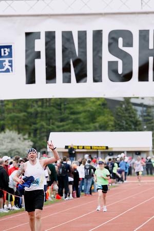 Record-Eagle/Jan-Michael Stump<br /> Runners finish the half-marathon in Saturday's 29th annual Bayshore Marathon.#4590