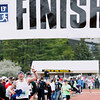 Record-Eagle/Jan-Michael Stump<br /> Runners finish the half-marathon in Saturday's 29th annual Bayshore Marathon.#4590