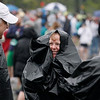 Record-Eagle/Jan-Michael Stump<br /> From left, Rod Smith (cq) of Howell, Craig Sweeney (cq) of Traverse City and Shannon Suarez (cq) of Interlochen use garbage bags to stay dry before the start of their race during Saturday's 29th annual Bayshore Marathon