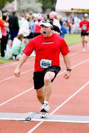 Record-Eagle/Jan-Michael Stump<br /> Runners celebrate their finish in the half-marathon in Saturday's 29th annual Bayshore Marathon. #4909