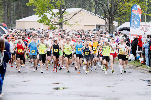 Record-Eagle/Jan-Michael Stump<br /> Runners start the 29th annual Bayshore Marathon on a rainy Saturday morning on the campus of Northwestern Michigan College.