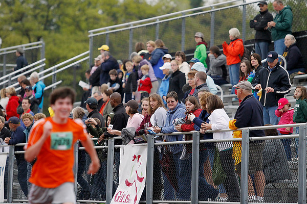 Record-Eagle/Jan-Michael Stump<br /> Crowds watch runners finish their races from the stands at Traverse City Central's track during 29th annual Bayshore Marathon.